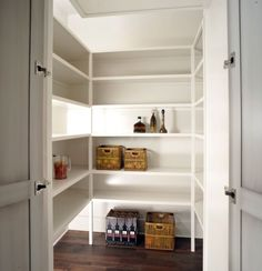 Dark pantry floors, white shelves, and under shelf lighting to brighten the space