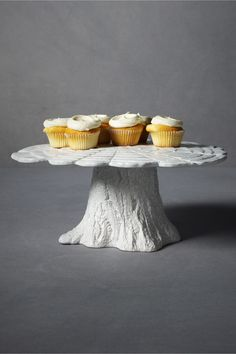 Knotty Pine cake plate...these can be made from REAL tree trunks and platters from the thrift store.  Have Dad pre-drill holes in the center of the platter to attach to tree trunk.