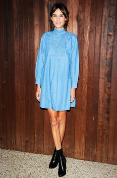 Alexa Chung pairs a long-sleeve denim dress with black leather boots
