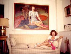 Paulette Goddard with Diego Rivera's painting of her, c.1940.