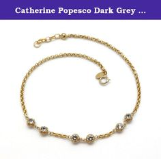 Catherine Popesco Dark Grey 6 Double Sided Ball Swarovski Crystal Gold Plated Wrap Bracelet/Choker. Rambling about Paris, Catherine Popesco discovered a treasure trove of stampings and molds - in the old factories and workshops of Paris, many that were created by the artists of the celebrated jewelry period from the 1900-1930's. With her vivid imagination, Catherine uses the invaluable treasures of the French artistic heritage and style to create an exquisite collection of handmade…