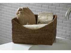 This beautiful bathroom shelf basket looks amazing on any shelving unit and is a lovely alternative to the traditional wicker basket. Line these varnished rattan baskets up along a shelf or place individually - a great place to store hand towels, bottles etc. They also make good book storage solutions too.