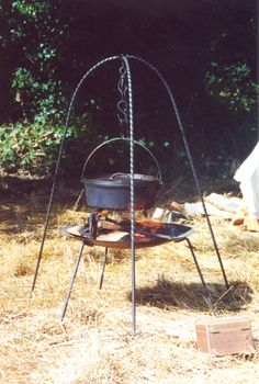 Cooking setup: Oseberg tripod with brazier... cast iron pot is not authentic to 900 AD