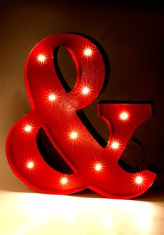 Easy to make DIY light up letters! Use wood or prefab letters w Christmas lights drilled in! ModCloth