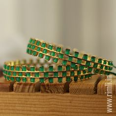 Traditional style bangles in green stones.Available in our at T Nagar, Chennai. WhatsApp us at Antique Jewelry, Gold Jewelry, Plain Gold Bangles, Bold Necklace, Latest Jewellery, Green Stone, Online Shopping Stores, Ladies Boutique, Fashion Jewelry
