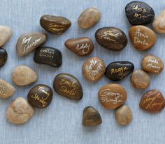 Provide smooth rocks from a sentimental location (perhaps the lake where you first vacationed) and ask guests to sign them with paint-style oil markers or enamel-based metallic pens. Place them in a glass cylinder, then display.