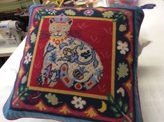 Jolly Red Renaissance Cat needlepoint, based on tapestries in the Mused de Cluny, Paris.