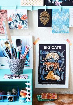Moodboard and blue office storage in the creative work space of Etsy seller Papio Press. See more home office style and share your own on #EtsyDeskie
