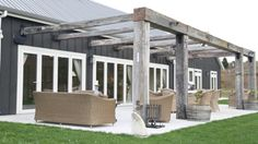 Robust weathered posts are used to make a striking pergola, the perfect complement to the Resene Bokara Grey exterior. Project by Customkit. Patio Pergola, Steel Pergola, Deck With Pergola, Pergola Shade, Patio Roof, Pergola Plans, Pergola Kits, Pergola Ideas, Patio Ideas