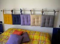 Cojín de cabecero de cama con un bonito acabado de cordones anchos