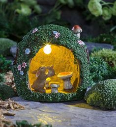 These bunnies give warm fuzzies! Our Solar Rabbit Warren Garden Accent will always make you smile. Inside of the the beautifully detailed cottage, a mother bunny snuggles with her baby in a heart-warming scene.