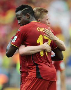 Belgium's Divock Origi embraces Belgium's Kevin De Bruyne after the group H World Cup soccer match between Belgium and Russia at the Maracan...