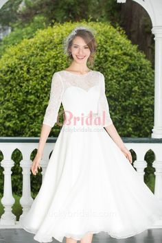 Pretty cute tea length informal lace and chiffon bridal gown. A super cutie tea length in a delicate white. Layers of soft chiffon skirt coupled with an illusion sheer lace neckline. Elbow length sleeves, matching with beaded sash.