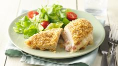 Don't be fooled by its fancy name—this baked chicken cordon bleu dinner couldn't be easier! Tender chicken breasts get stuffed with chopped ham and shredded Swiss cheese for an unfussy, delicious twist on traditional chicken cordon bleu. Le Cordon Bleu, Cordon Bleu Recipe, Cordon Blu, Easy Baked Chicken, Chicken Recipes, Crispy Chicken, Easy Family Dinners, Easy Meals, 5 Ingredient Dinners