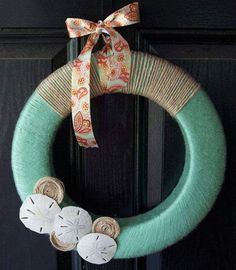 I made this using shells and sand dollars we collected from the beach.  I covered all the bottom half of the wreath and I did not attach a bow. Love it. TWK