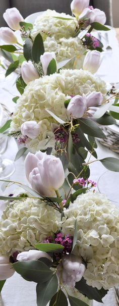 Beautiful Easter table flowers. The purple hues and white hydrangeas are perfect for spring.