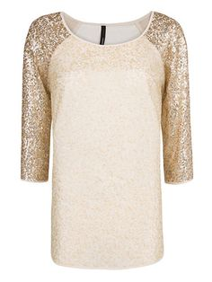 Sparkly cream and gold tunic.