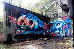 Hand holding skull. Graffiti by Nychos