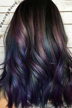 Try rainbow hair that is rich, dark, fantastic and mysterious. The new oil slick hair trend allows brunettes to get awesome look without any harsh bleaching
