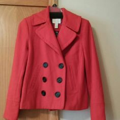 Forever 21 Pea Coat Stylish redish - orange, double breasted, 3 buttons on each coat sleeve, pocket splits but no pockets, and  pleated down the middle on back of coat. Forever 21 Jackets & Coats Pea Coats