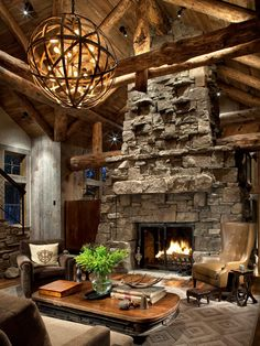 Great Room Fireplace for the Falcon Ridge House Love light fixture, color of stone (sigh) and coffee table. Love!