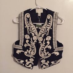 NWT H&M Conscious 2014 Embroidered Vest Sz 10 Amazing vest- from H&M Conscious 2014 Spring Collection and this is one of the statement piece! Size 10 but runs a bit small so it's best for size 6-8! Sold out everywhere and this is such an unique piece I got it for a pretty high price because it's completely sold out.. Feel free to offer and fee free to ask any questions you might have! Thank you all lovelies! H&M Jackets & Coats Vests