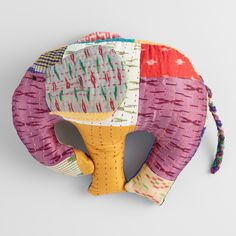 We adore this lively throw pillow from the Gudari region of India. The elephant silhouette is cleverly crafted in a patchwork pattern of bright braided silk sari remnants.