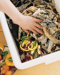 "Line the bottom of the bin with 6 inches of cornstalks, coarse twigs, or chopped brush. Add a few inches of ""green"" (think fruit and vegetable scraps, flowers, etc.), then twice as much ""brown"" material (think fallen leaves, paper egg cartons, straw, etc.)."