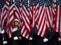 Firefighters hold flags representing the 343 firefighters who were killed during the 2001 terror attacks as they march in the St. Patrick's Day parade on March 17 in New York City.  Justin Lane, European Pressphoto Agency