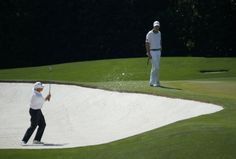 U.S. golfer Fred Couples hits a shot out of the sand trap on the fourth hole as playing partner Jimmy Walker of the U.S. (R) looks on during the third round of the Masters golf tournament at the Augusta National Golf Club in Augusta, Georgia April 12, 2014. REUTERS/Mike Blake