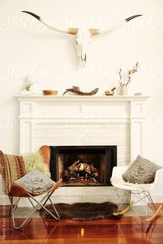 Fantastic Artsy !   Living room with fireplace, steer head, and chairs by Trinette Reed