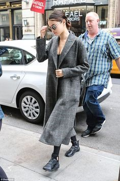 Not in the mood for a close up: Selena Gomez kept her head down as she was seen in New York City on Saturday