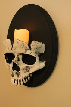 Due to popularity Please allow up to 2 weeks for the pieces to be created and shipped.  This listing is for a set of my skull sconces. I use one of my skulls then attach it to wood. Then added jagged lines to create the broken skull look. Each skull will be slightly different.  The wood the