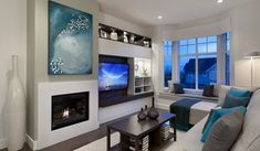 Teal and gray living room with built in entertainment center