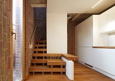 Small London home by Satish Jassal Architects is clad in brick both inside and out.