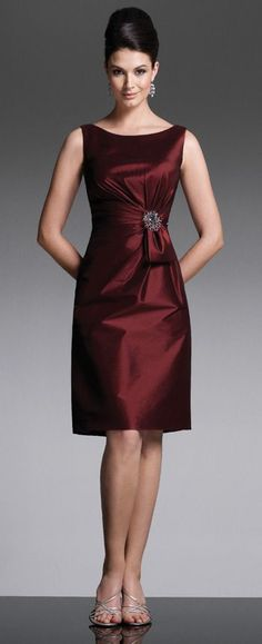 Sleeveless stretch taffeta knee-length sheath with bateau neckline, side gathered bodice features sash accent with removable jewel brooch, gathered deep V-back. Matching shawl included.