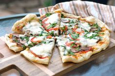 It's not just burgers and grilled chicken that can grace the top of your grill — you can make pizza, too. And it's easier than you think. Get a bit of help from a metal pizza pan, which goes directly onto the grill. Layer on toppings, and you'll have melty pizza in minutes to serve alongside your favorite barbecue foods.