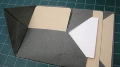 This envelope fold (not made by me) is the same as the one with the card inserts above, but it better illustrates where the potential pocket...