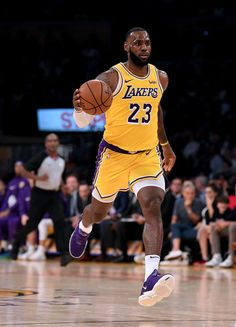 805d7f2ee59a4 LeBron James Photos - LeBron James  23 of the Los Angeles Lakers carries  the ball