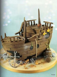 Old wooden boat cake with anchor, fish, beached wooden boat sculpted cake Debbie Brown Good idea for gingerbread. Fancy Cakes, Cute Cakes, Fondant Cakes, Cupcake Cakes, Debbie Brown, Pirate Ship Cakes, Boat Cake, Nautical Cake, Sculpted Cakes