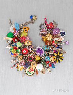 Day of the Dead Charm Bracelet - loaded with skulls and vintage trinkets by janedean. #dayofthedead #diadelosmuertos