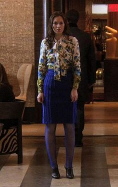 Lovely floral cardigan and royal blue skirt.