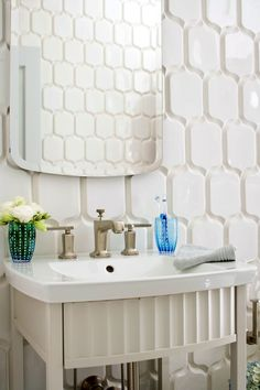 Small bathrooms have the potential to pack in plenty of style within a limited footprint. By employing design elements and storage solutions in strategic ways, you can create an attractive small bathroom with big impact. Use these small-bathroom decorating ideas to add polish and function in a tight space. #smallbathroom #bathroomdecor #bathroomideas #apartmentbathrooms #bhg