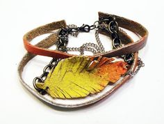 Leather Strap and Feather Bracelet by Beatniq on Etsy, $25.00