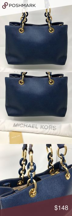"""Michael Kors Cynthia Leather Navy Medium Satche Condition: Gently used. Good condition inside and out.   This satchel is replete with sophisticated details, from its leather-trimmed chain-link handles to the convertible, buckle-fastened shoulder strap. An array of interior pockets and a top-zip closure keep all of your essentials organized and secure.  12-1/2"""" W x 9-1/4"""" H x 5"""" D. Style 30S3TCYS2L. Our bag # RB372  Thank you for your interest!  PLEASE - NO TRADES / NO LOW BALL OFFERS / NO…"""