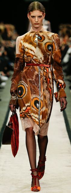Weird. But it is cool to see the back of the Blue Morpho's wings being given some attention! Givenchy Fall 2014| The House of Beccaria#