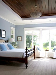 Luxury Home Tour: Tudor Home with Modern Updates - love this bedroom with blues, white trim, and that wood ceiling!