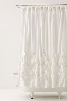Ruffled appliques crest and fall atop a sea of crisp white voile
