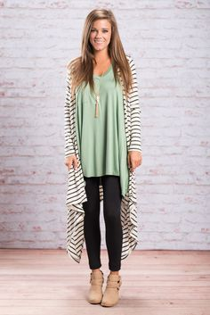 This cardigan really is oh so perfect for fall! It's fabric is amazingly soft and the fabric is light weight. We are loving the dramatic length too! It give this classic cardi a nice little edge! It's going to look so good over so many of your fall outfits!