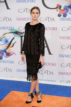 2014: Olivia Palermo wore an Ann Taylor outfit. I like the black sweater with the black skirt with fringe on the bottom. Those shoes are just to die for gorgeous! Olivia always looks fashionable! Perfect for the event